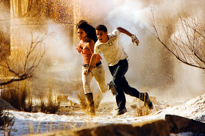 Megan Fox and Shia LeBoeuf running from an explosion in Transformers 2
