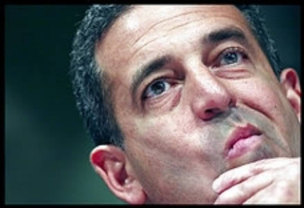 Russ Feingold, holding his chin, looking like he is deciding something.